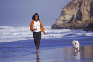 Beach + woman + dog